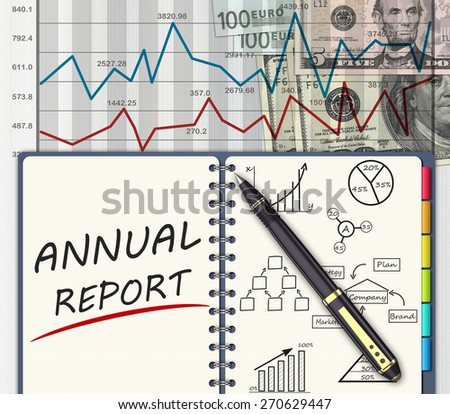 Office table with the annual financial report - stock photo