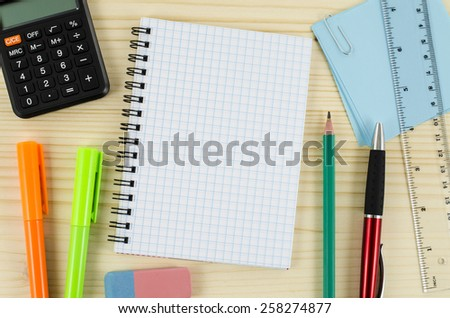 Office tools with blank notebook on wooden table - stock photo