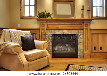 Office with comfortable chair and fireplace - stock photo