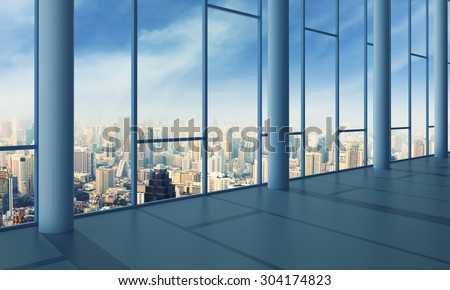 Office with glass wall and sunset - stock photo