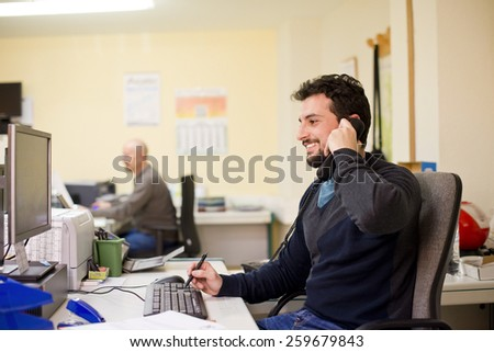 Office with people that looks real working - stock photo