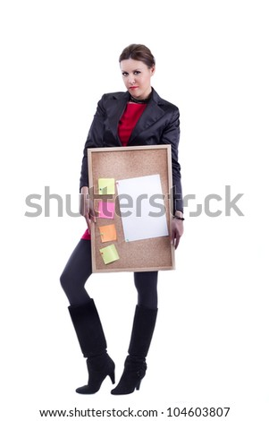 Office woman in black suit and high heel boots holding a plywood board with empty color notes and a lettersize plain paper for a to do list - stock photo