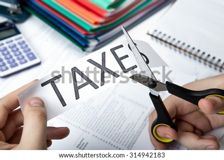 office work and metaphor for the payment of taxes - stock photo