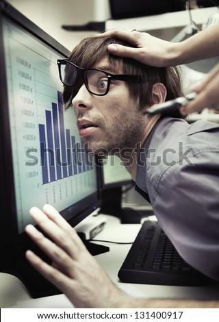 office worker forced to work harder - stock photo