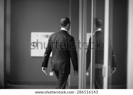 Office worker going through an office - stock photo