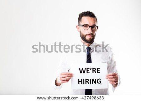 office worker or businessman with glasses showing his company is going to hire - stock photo