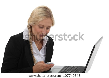 Office worker sending SMS - stock photo