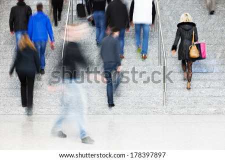 Office Worker Walking Up Stairs, Motion Blur - stock photo