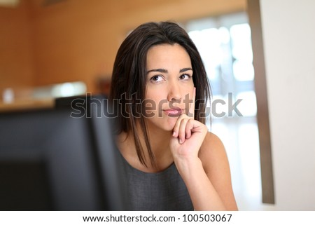 Office worker with interrogative look on her face - stock photo