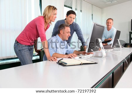 Office workers in a training course - stock photo