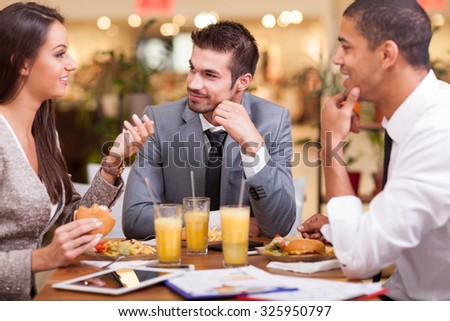 office workers on lunch at the restaurant - stock photo
