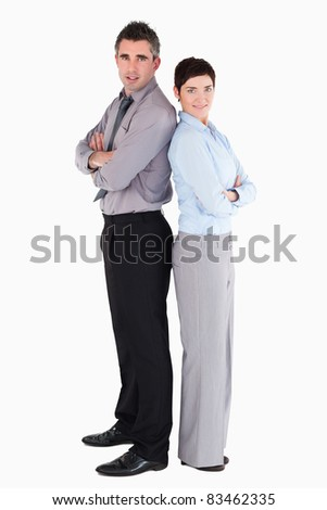 Office workers standing up back to back against a white background - stock photo