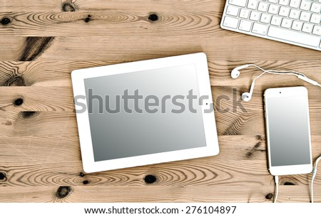 Office Workplace with Keyboard, Tablet PC IPad, IPhone, Headphones - stock photo