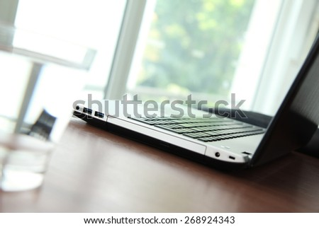 Office workplace with laptop and smartphone on wood table - stock photo