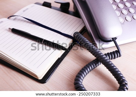 Office workplace with phone set close up - stock photo