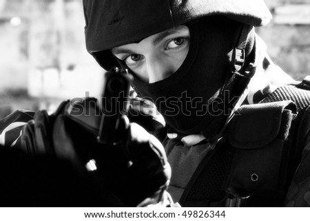 Officer in full ammunition with semi-automatic 9mm glock pistol - stock photo