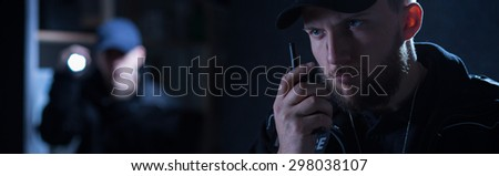 Officer is calling for a back up on shortwave radio - stock photo