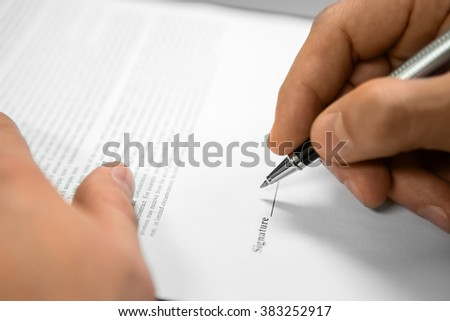 Official signs a document. In need of law protection. Protecting company's name. Signing a legal document. - stock photo