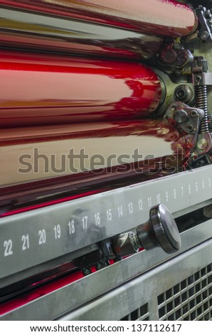offset printing press industry machine rollers - stock photo