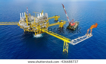 Offshore construction platform for production oil and gas, Oil and gas industry and hard work,Production platform and operation process by manual and auto function, oil and rig industry and operation. - stock photo