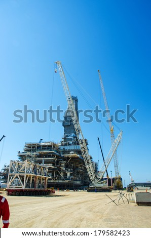 Offshore drilling during construction onshore - stock photo