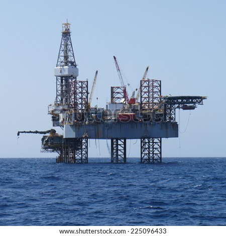 Offshore Jack Up Rig and The Production Platform - stock photo