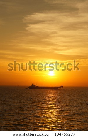Offshore Oil Tanker in The Middle of The Ocean at Sunset Time - stock photo