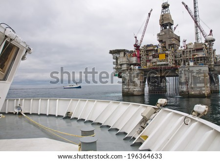 Offshore Platform together with Seismic Survey Vessels and Offshore Supply ships - stock photo