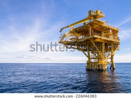Offshore production platform in the sea for oil and gas production. - stock photo