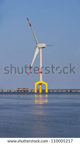 Offshore wind turbine - stock photo