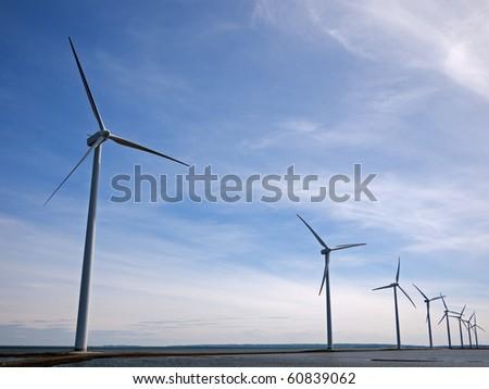 Ofshore wind park turbines - stock photo