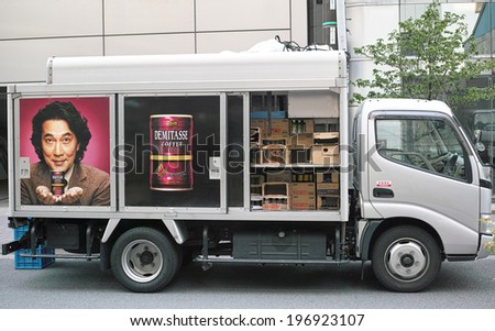 OGAWAMACHI, TOKYO - APRIL 17: Delivery truck of Dydo Drinco, Inc. on April 17, 2014. Dydo is a Japanese popular brand of canned coffee. The guy appears in the left side is japanese actor Koji Yakusho. - stock photo