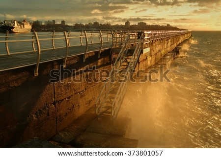 Ogden Point Waves. Sunrise at Ogden Point, Victoria, British Columbia. Waves crash into the breakwater from the Strait of Juan de Fuca.  - stock photo
