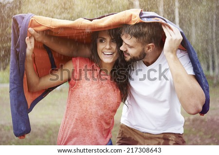 Oh baby, I have to protect you from the rain  - stock photo