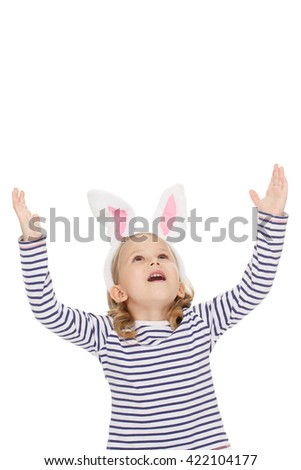 Oh my! Studio shot of a little beautiful girl looking excitedly at the copyspace above spreading her hands - stock photo