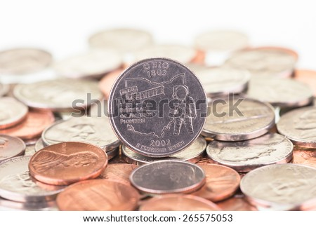 Ohio State quarter with other coins close up  - stock photo