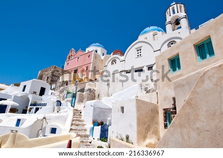 Oia cityscape with cave houses on the island of Santorini, Greece. - stock photo