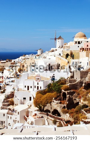 Oia, Santorini. View of famous windmill on cliff side.  - stock photo