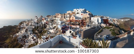 Oia traditional village at Santorini island in Greece. Panoramic image - stock photo