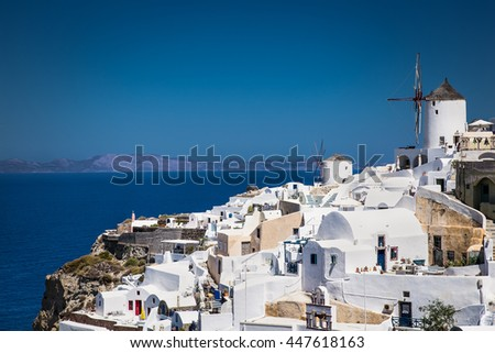 Oia village at suny day on Santorini island, Greece