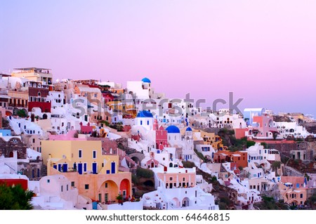 Oia village buildings in the evening light - stock photo