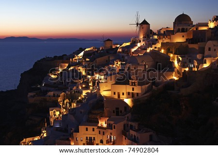 Oia white wash building at dusk in santorini island Greece - stock photo