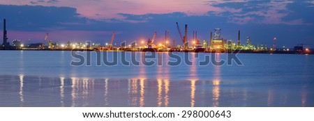 Oil and fuel production refinery in night time - stock photo