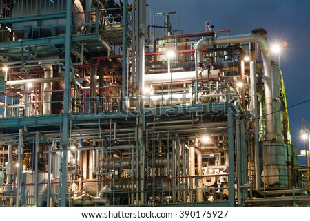 Oil and gas industry at night - stock photo