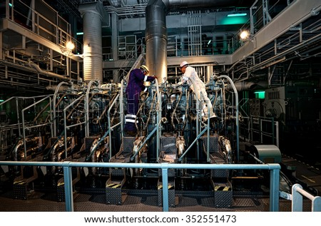 Oil And Gas Industry. Engineers conduct maintenance engine tanker. industrial - stock photo