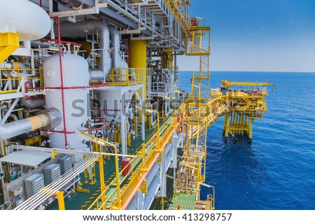 Oil and gas industry, processing platform produced gas and condensate then sent to onshore refinery and petrochemical plant. - stock photo