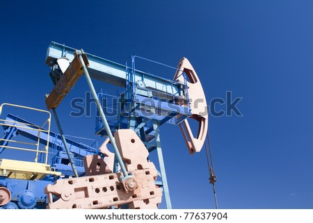 Oil and gas industry. Work of oil pump jack on a oil field. Wide angle - stock photo