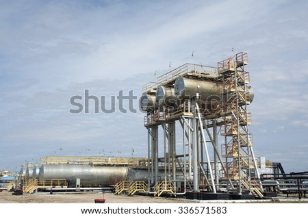 Oil and gas industry. Work of refinery petrochemical plant. Oil reservoir and storage tank. Gas station - stock photo