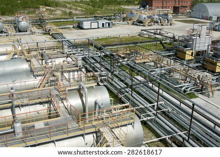 Oil and gas industry. Work of refinery petrochemical plant. Oil reservoir and storage tank of mineral oil. Gas station - stock photo