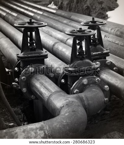 Oil and gas pipe line and valves. Black and white photo - stock photo